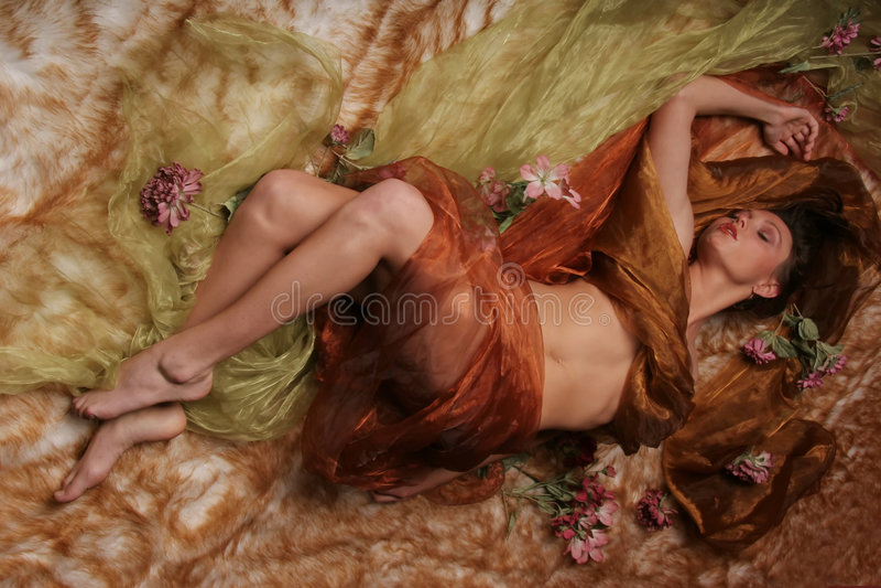 Beautiful woman sleeping. Woman wrapped in silk sleeping stock images