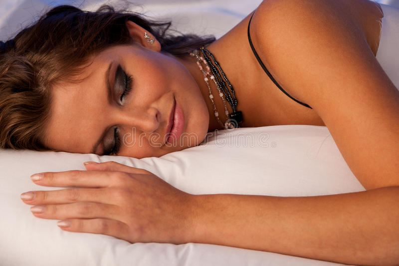 Beautiful woman sleeping in bed stock images