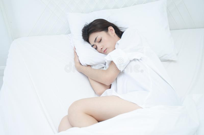 Women wearing white pajamas are resting royalty free stock photos