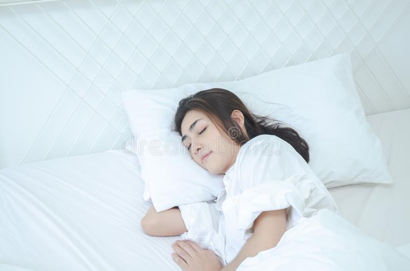 Women wearing white pajamas are resting stock photography