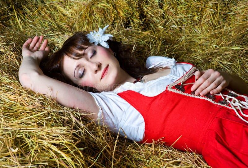 Beautiful woman sleeping on the hay