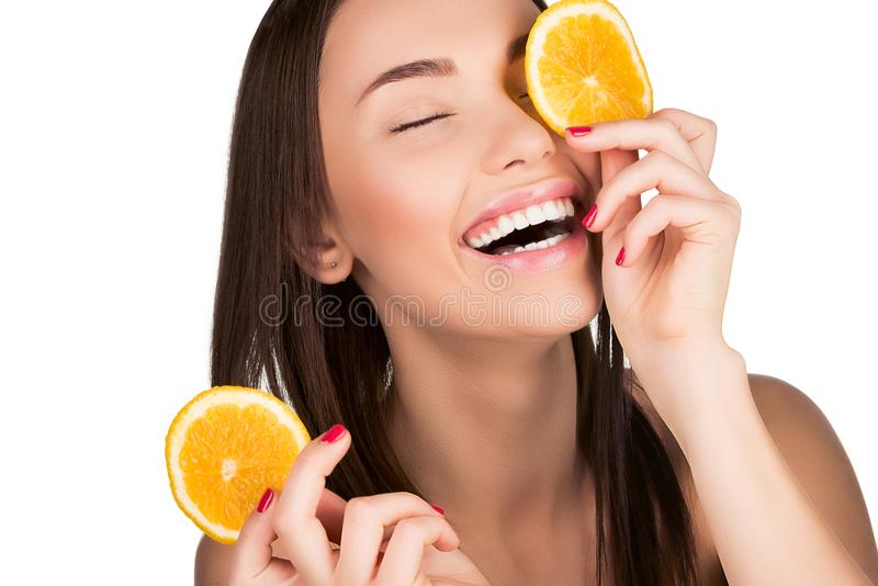 Woman with sliced orange stock image
