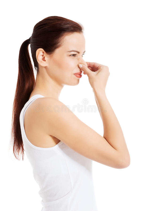 Beautiful woman smells bad scent. Isolated on white stock image