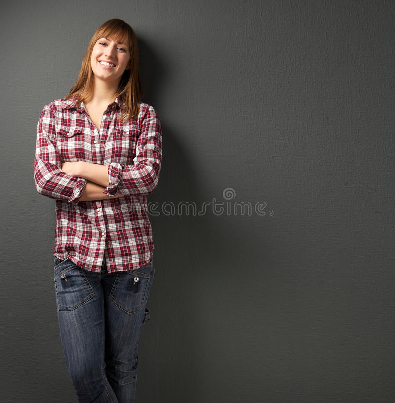Beautiful woman smiling on gray background