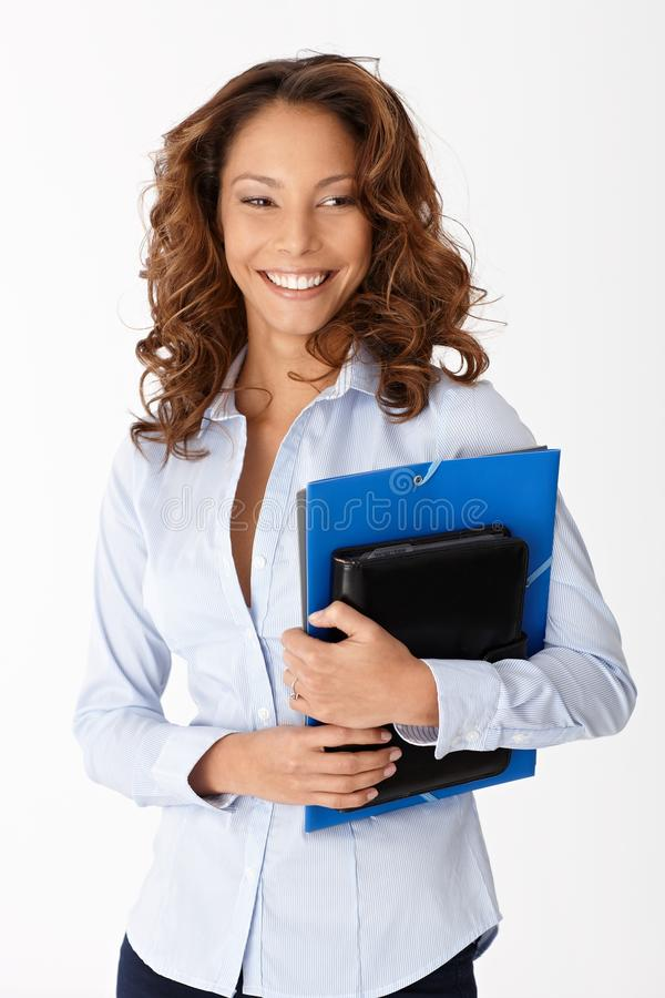 Download Beautiful Woman Smiling Holding Folders Stock Photo - Image: 23992796