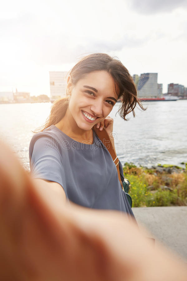 Beautiful woman smiling and talking selfie. Portrait of beautiful woman smiling and talking selfie royalty free stock photography
