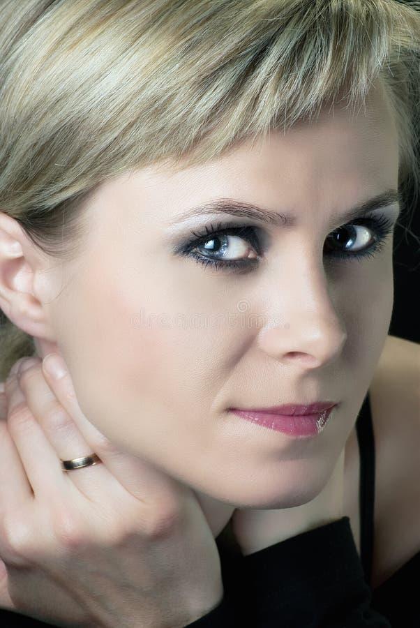 Beautiful Woman With Smokey Eyes Make-up Stock Photo