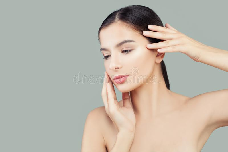 Beautiful woman spa model with healthy clear skin. Facial treatment and skin care concept stock photos