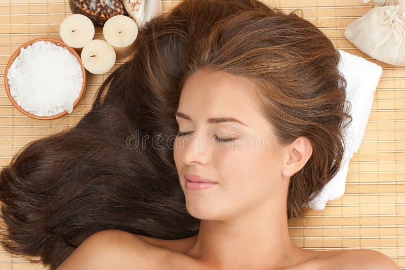Beautiful woman at spa salon stock photo