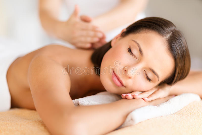 Beautiful woman in spa salon getting massage stock images
