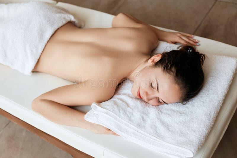 Beautiful woman in spa salon having body relaxing massage. Body care. Spa. Woman having massage in th. E spa salon stock image