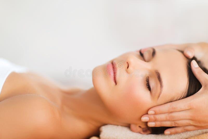Beautiful woman in spa salon having facial stock images