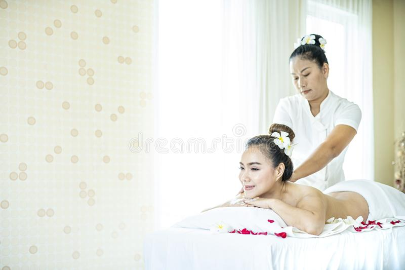 Beautiful woman in spa. Young and healthy female in spa. Asian woman in wellness beauty spa having aroma therapy massage with stock image