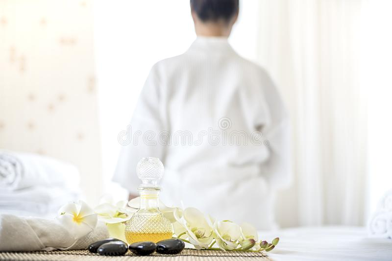 Beautiful woman in spa. The young woman is waiting to sit in the spa on the window. Asian woman in wellness beauty spa having royalty free stock photography