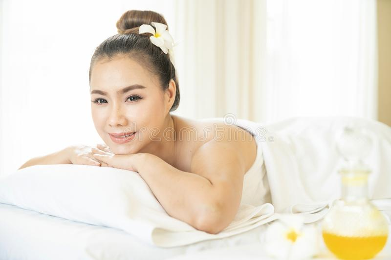 Beautiful woman in spa. The young woman is waiting to sit in the spa on the window. Asian woman in wellness beauty spa having. Aroma therapy massage with royalty free stock photos