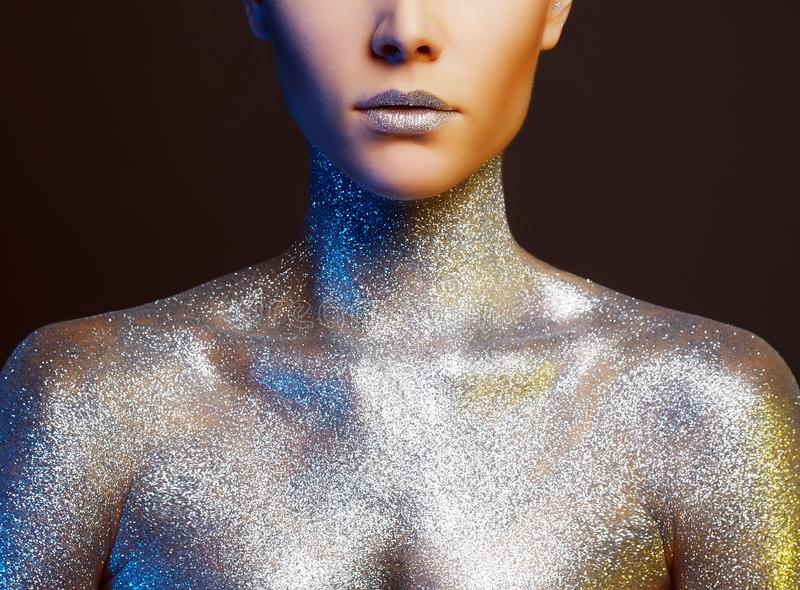 Beautiful Woman with Sparkles on Body. Portrait of Beautiful Woman with Sparkles on Body. Girl with Art Make-Up in color spotlights stock image