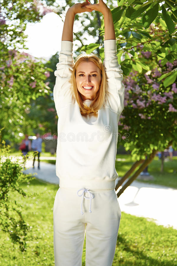 Beautiful woman sport gymnastics green park nature summer smile royalty free stock photography