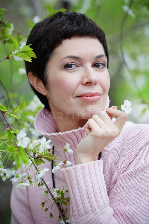 Beautiful woman in spring. Portrait of beautiful middle aged woman in spring stock images