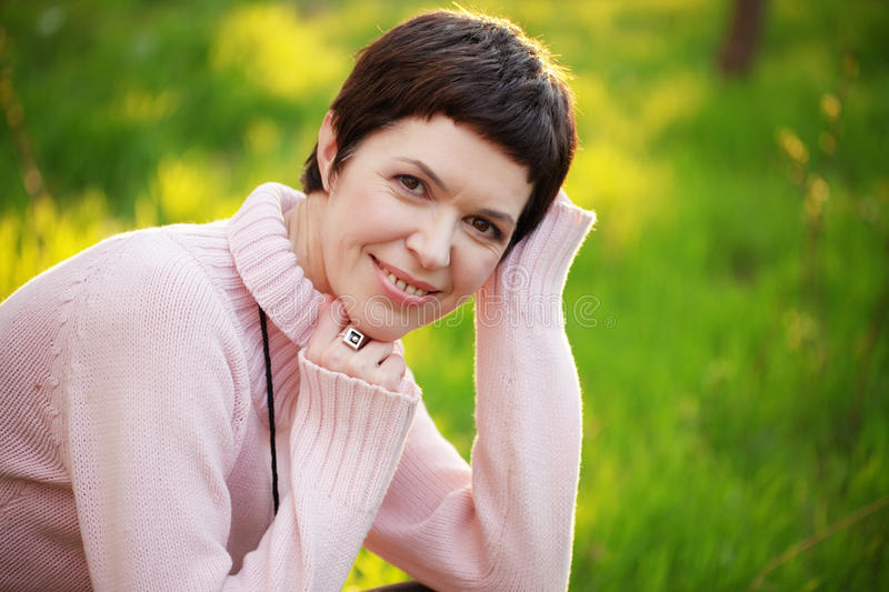 Beautiful woman in spring. Portrait of beautiful middle aged woman in spring royalty free stock images