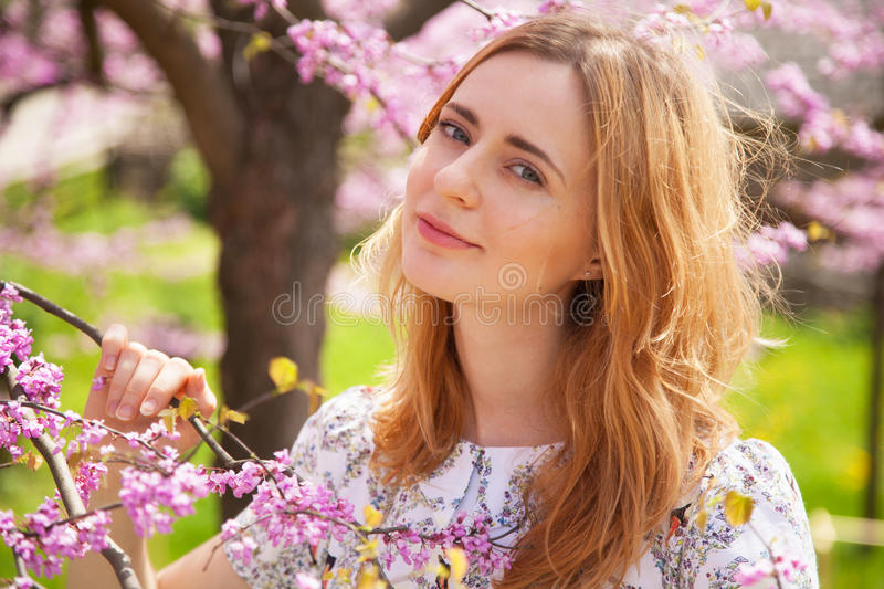 Beautiful woman in spring blossom.  stock photos