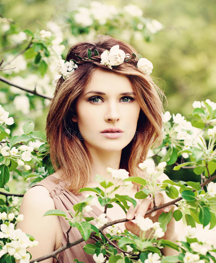 Beautiful Woman in Spring. Blossom stock images