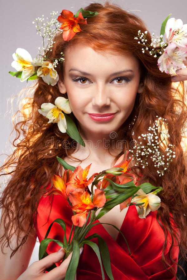 Beautiful woman with spring flowers. Portrait of beautiful woman with spring flowers stock photo