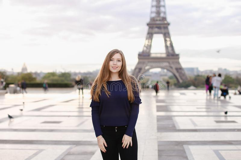 Beautiful woman standing in Eiffel Tower background in Paris. stock images