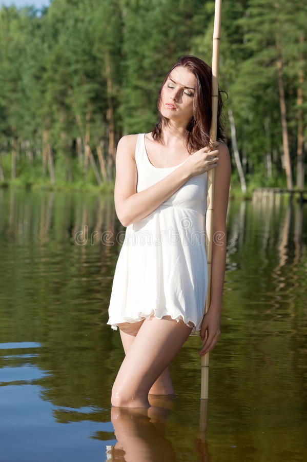 Beautiful Woman Is Standing In The Lake. Stock Image