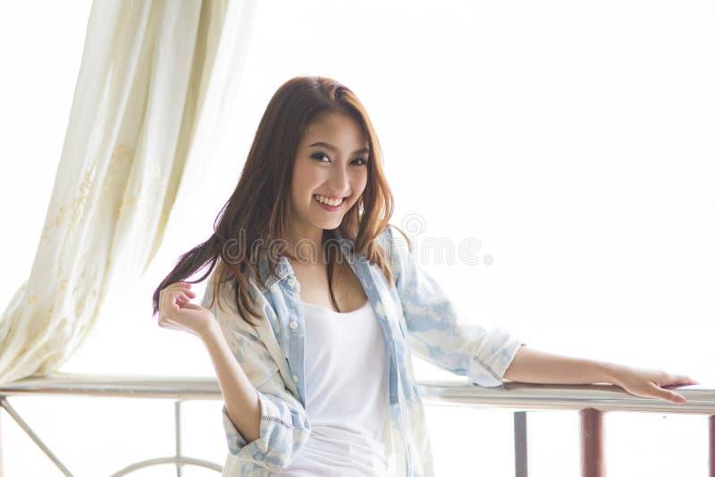 Beautiful woman standing among morning sunshine stock photo