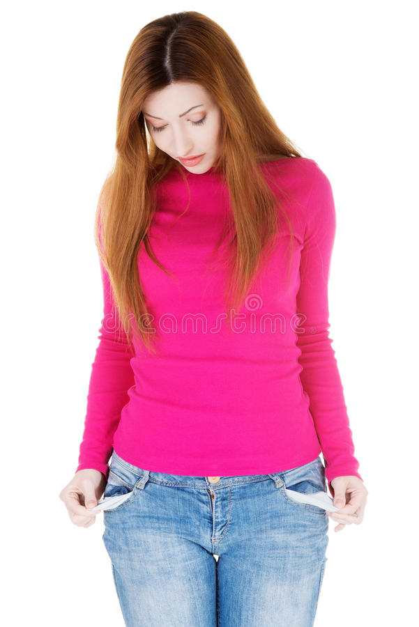 Download Beautiful Woman Standing And Showing Her Empty Pockets. Stock Photo - Image: 35045828