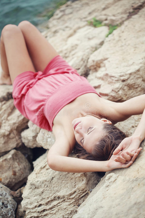 Beautiful woman on stones royalty free stock photo