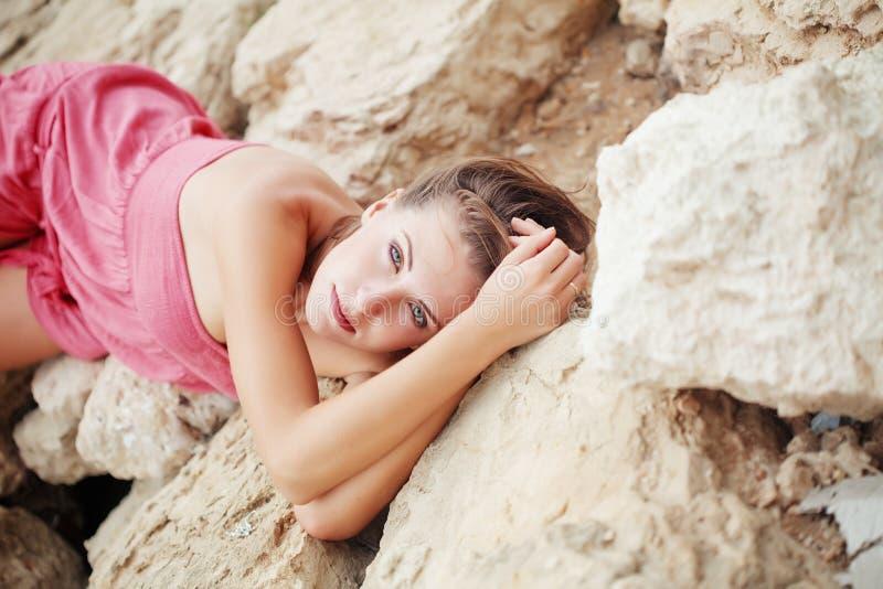 Beautiful woman on stones royalty free stock image