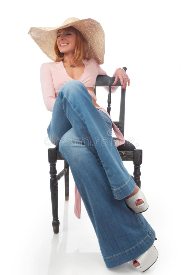 Beautiful Woman In A Straw Hat Stock Photo
