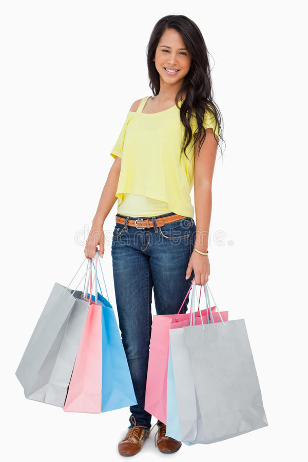 Download Beautiful Woman Student With Shopping Bags Royalty Free Stock Image - Image: 25334976