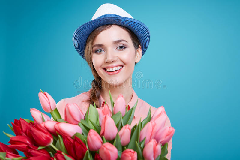 Beautiful woman studio portrait with tulip flowers stock photography
