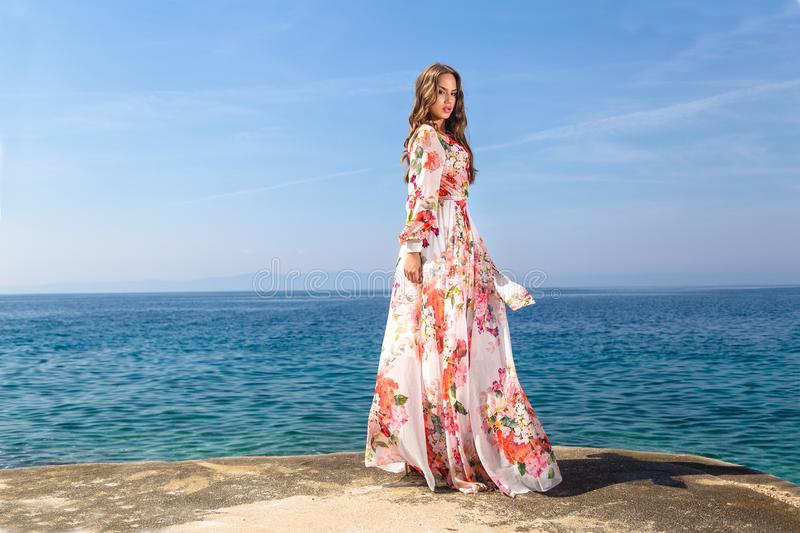 Woman in a summer dress royalty free stock photography