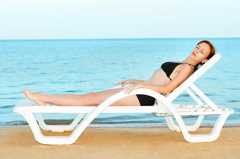 Download Beautiful woman sunbathing stock photo. Image of paradise - 12276088