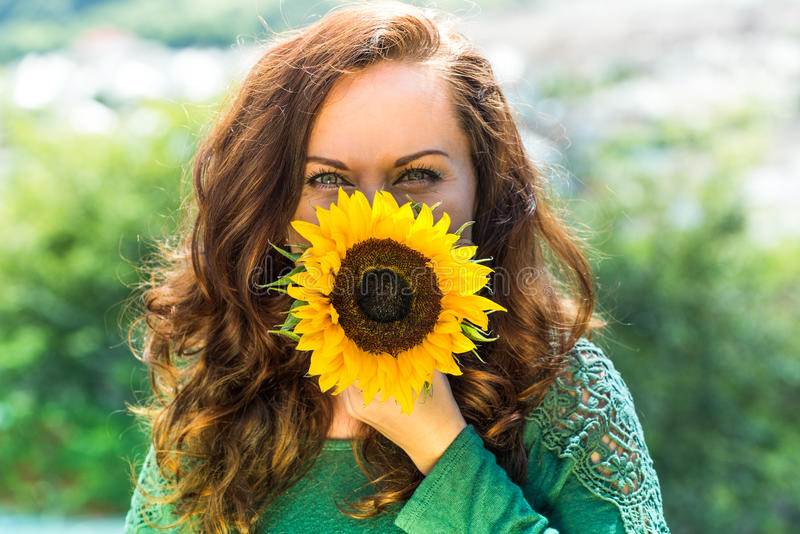 Beautiful woman with sunflower stock images
