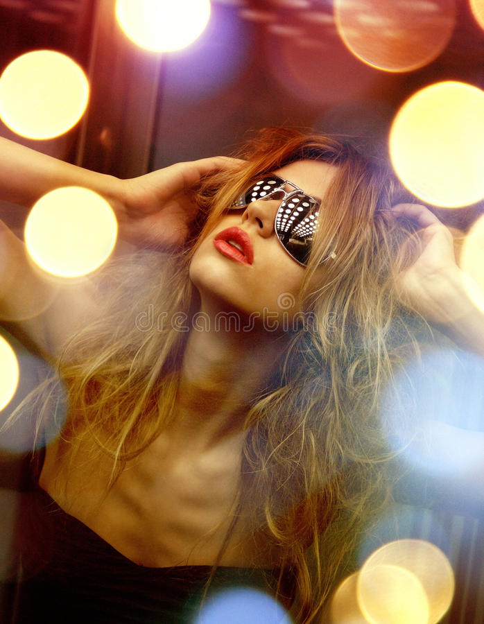 Beautiful woman in sunglasses in elevator royalty free stock photography