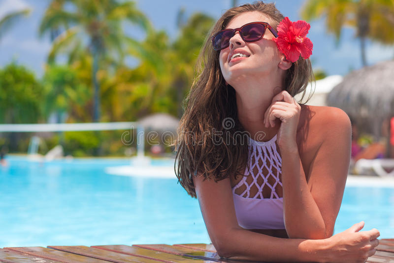 Beautiful woman in sunglasses in the pool royalty free stock photos