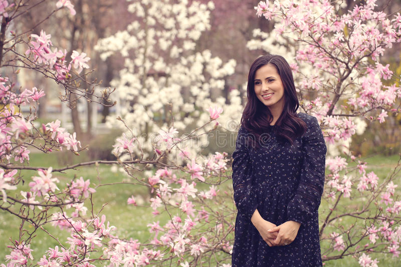 Beautiful woman surrounded by flowers royalty free stock images