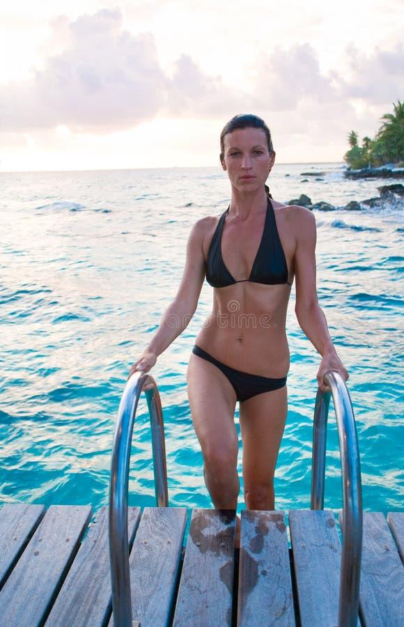 Beautiful woman swim stock photography