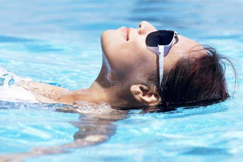 Beautiful woman swimming royalty free stock photo