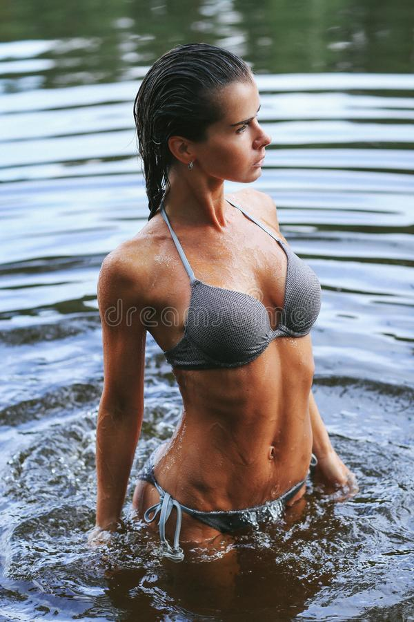 Girl in the lake royalty free stock image