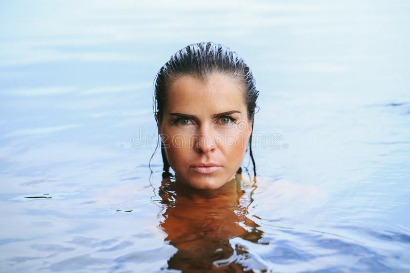 Girl in the lake royalty free stock images