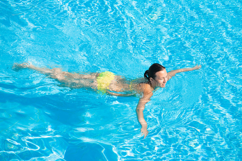 Download Beautiful Woman Swimming In Pool Stock Photo - Image: 7141010