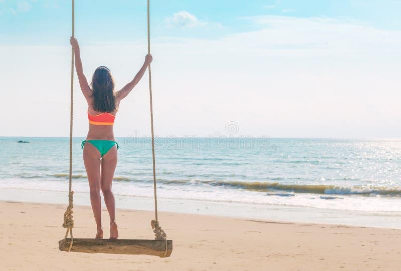 Beautiful woman swinging at tropical beach in Khao Lak region. Thailand, Asia royalty free stock photo