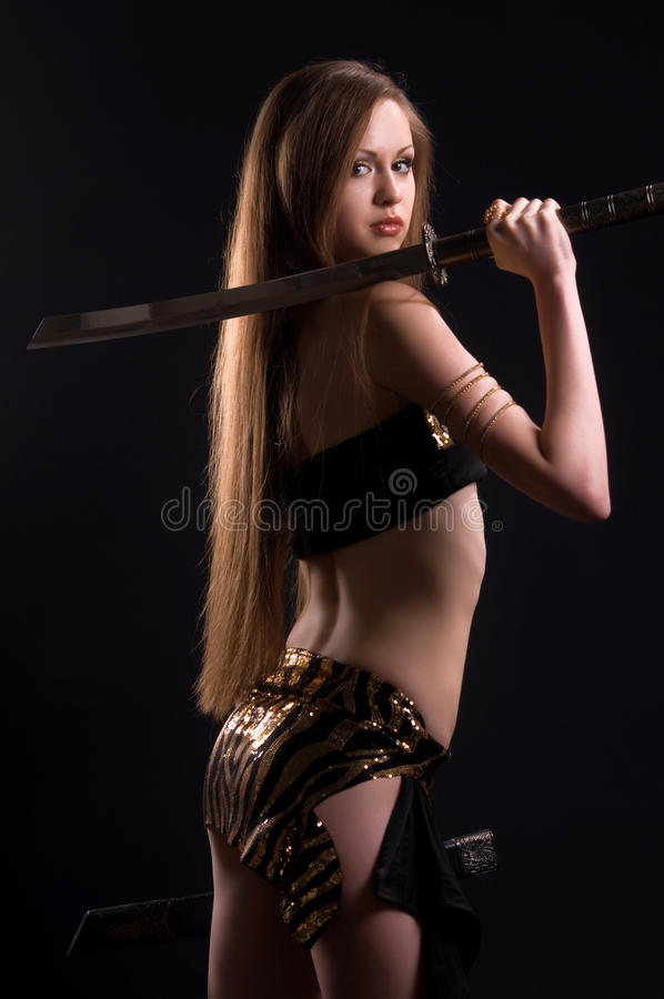 Beautiful woman with a sword in the studio royalty free stock photos