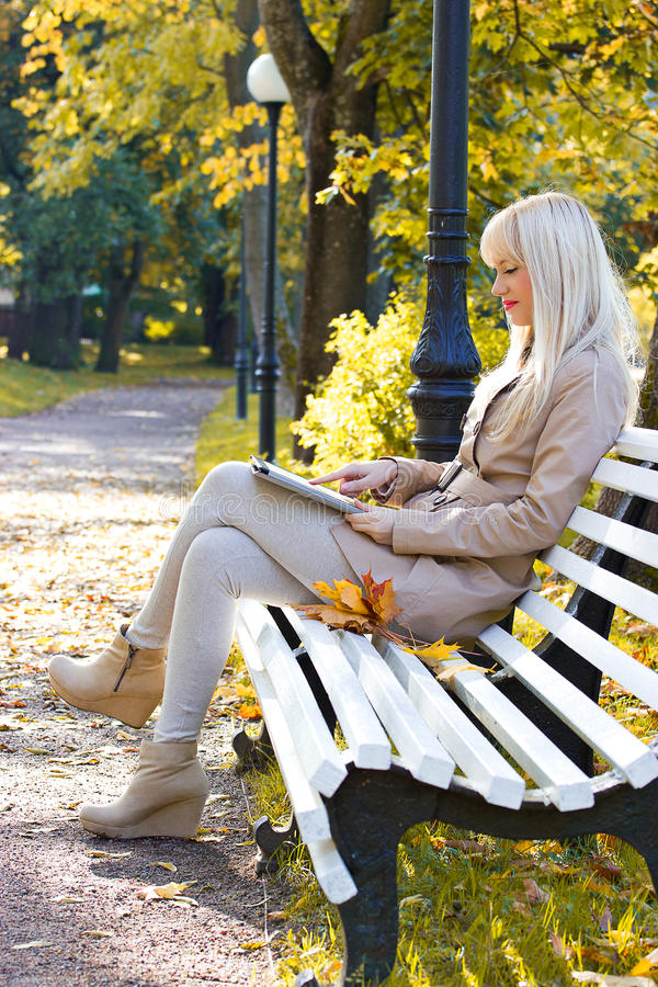 Download Beautiful Woman With Tablet Pc Outdoor Stock Image - Image: 26965463