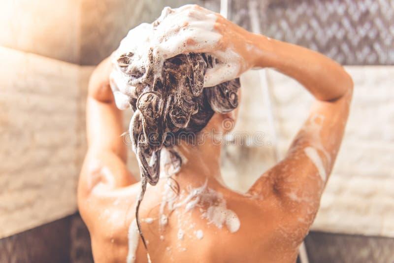 Beautiful woman taking shower royalty free stock image